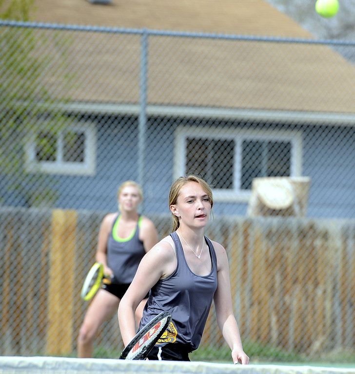 . Thompson Valley\'s Jordan Mertens watches her return as No. 1 doubles partner Danielle Sobraske looks on during Thursday\'s crosstown match with Mountain View. (Mike Brohard/Loveland Reporter-Herald)