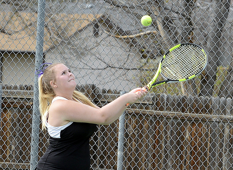 . Mountain View No. 2 singles player Audra Axline concentrates on her return during Thursday\'s crosstown match with Kylie Jacobson at the TVHS courts. (Mike Brohard/Loveland Reporter-Herald)