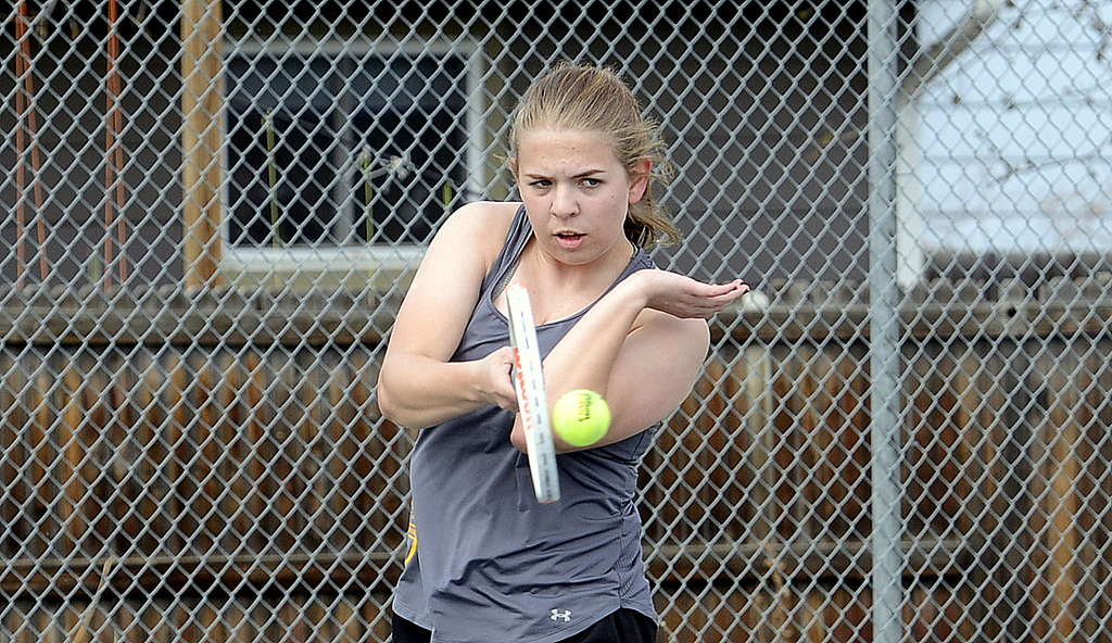 . Anna Cormos keeps her form tight for the return in her No. 3 singles match with Mountain View\'s Kendall Kreiger during Thursday\'s crosstown dual at the TVHS courts. (Mike Brohard/Loveland Reporter-Herald)