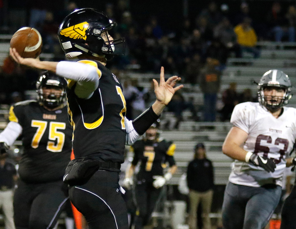 . Thompson Valley�s Ti Smack (11) reaches back to pass the ball on Thursday, Sept. 28, 2017, at Patterson Field. (Photo by Lauren Cordova/Loveland Reporter-Herald)