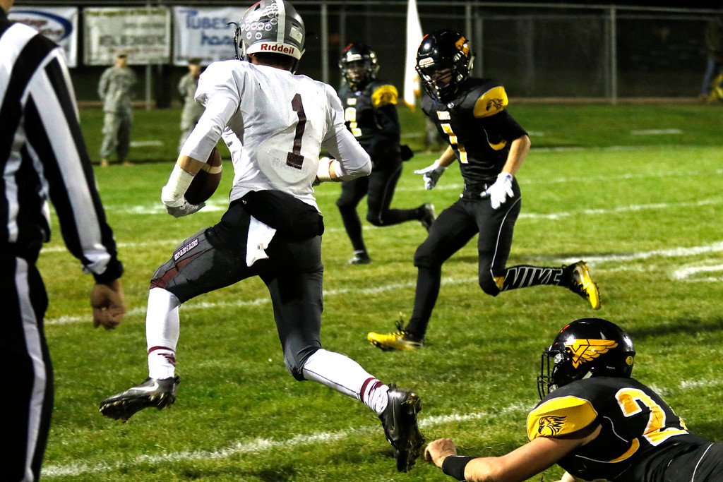 . Berthoud�s Jacob Lozinski (1) runs for a touch down as Thompson Valley�s Caleb Burton (24) jumps to tackle him on Thursday, Sept. 28, 2017, at Patterson Field. (Photo by Lauren Cordova/Loveland Reporter-Herald)