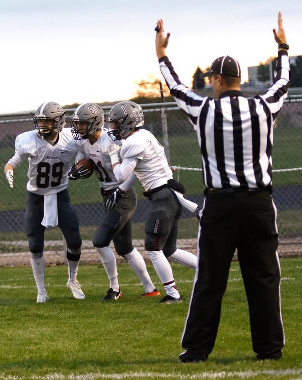 . Berthoud�s Jacob Rafferty (89) and Jacob Lozinski (1) congradulate Ryan Schmad (81) on scoring the first touchdown of the night on Thursday, Sept. 28, 2017, at Patterson Field. (Photo by Lauren Cordova/Loveland Reporter-Herald)
