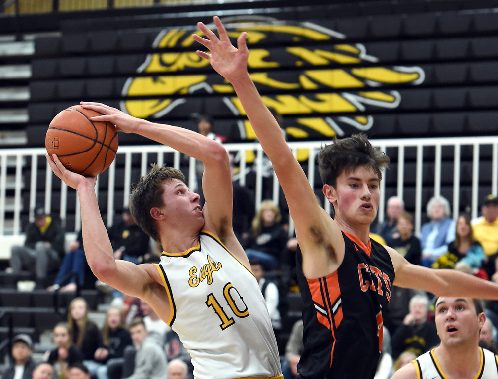 . Thompson Valley\'s (10) Justin Wiersema goes up for a shot past Greeley Central\'s (4) Marcos Hernandez during their game Monday, Feb, 12, 2018, at Thompson Valley in Loveland. (Photo by Jenny Sparks/Loveland Reporter-Herald)