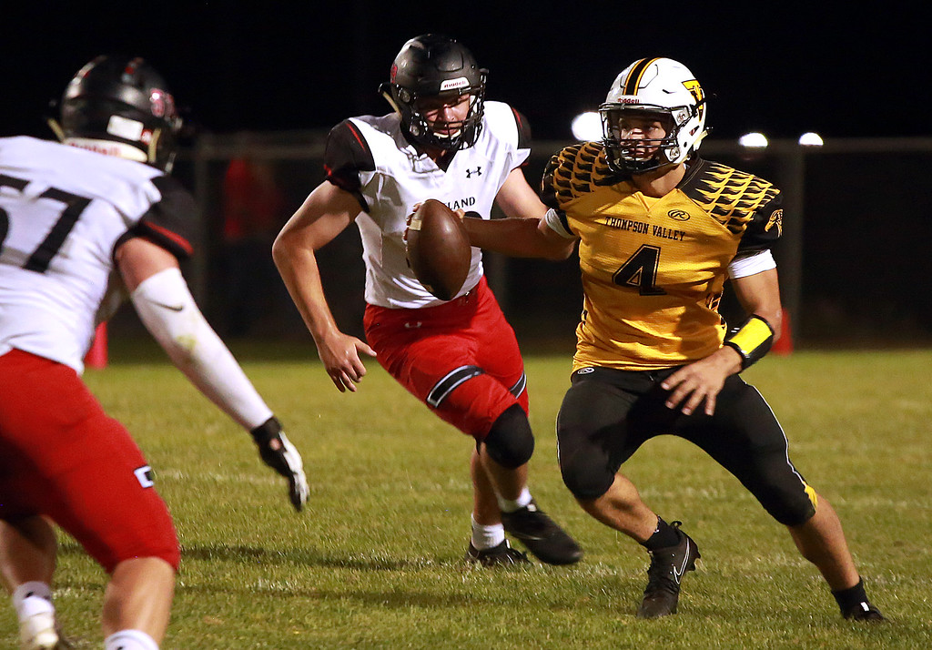 . Thompson Valley�s (4) Cam Nellor searches for a route to the endzone during their game against Loveland Friday, Sept. 7, 2018 at Patterson Stadium in Loveland. (Photo by Taelyn Livingston/Loveland Reporter-Herald)