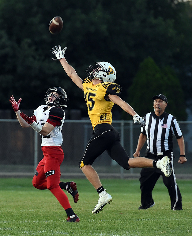 . Thompson Valley\'s (15) Trey Kreikmeier tries to intercept a touchdown pass to Loveland\'s (22) Mason Adams during their game Friday, Sept. 7, 2018, at Patterson Stadium in Loveland.  (Photo by Jenny Sparks/Loveland Reporter-Herald)