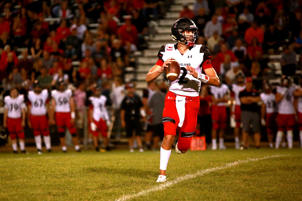 . Loveland�s (2) Riley Kinney looks for an open teammate at the Firday night game against Thompson Valley on Friday Sept. 7, 2018, at Patterson Stadium in Loveland. (Photo by Taelyn Livingston/Loveland Reporter-Herald)