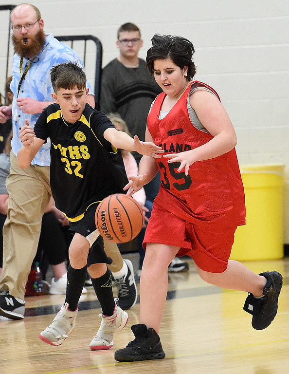 . Loveland Unified\'s (35) Allie Westman and Thompson Valley Unified\'s (32) Noah Goodson try to get control of the ball during their game on Thursday, Feb. 15, 2018, at Thompson Valley High School in Loveland. (Photo by Jenny Sparks/Loveland Reporter-Herald)