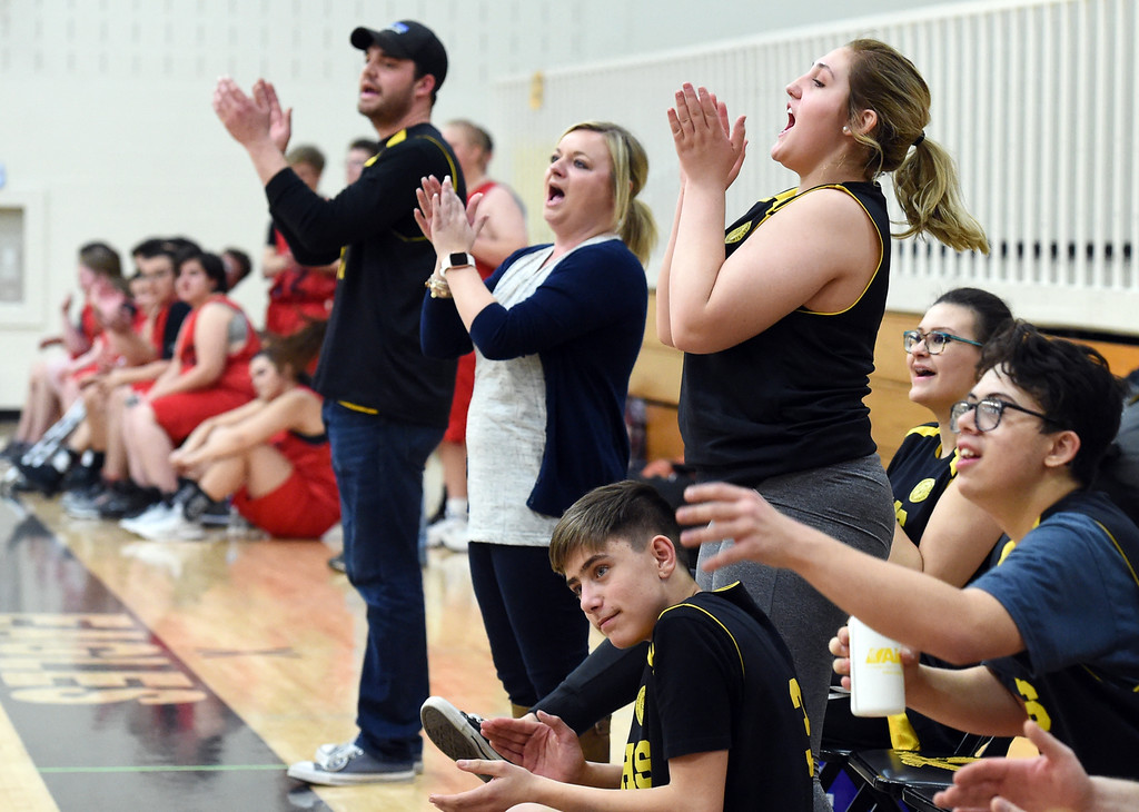 . Thompson Valley Unified\'s players and coaches cheer on their team during their game against Loveland Unified on Thursday, Feb. 15, 2018, at Thompson Valley High School in Loveland. (Photo by Jenny Sparks/Loveland Reporter-Herald)