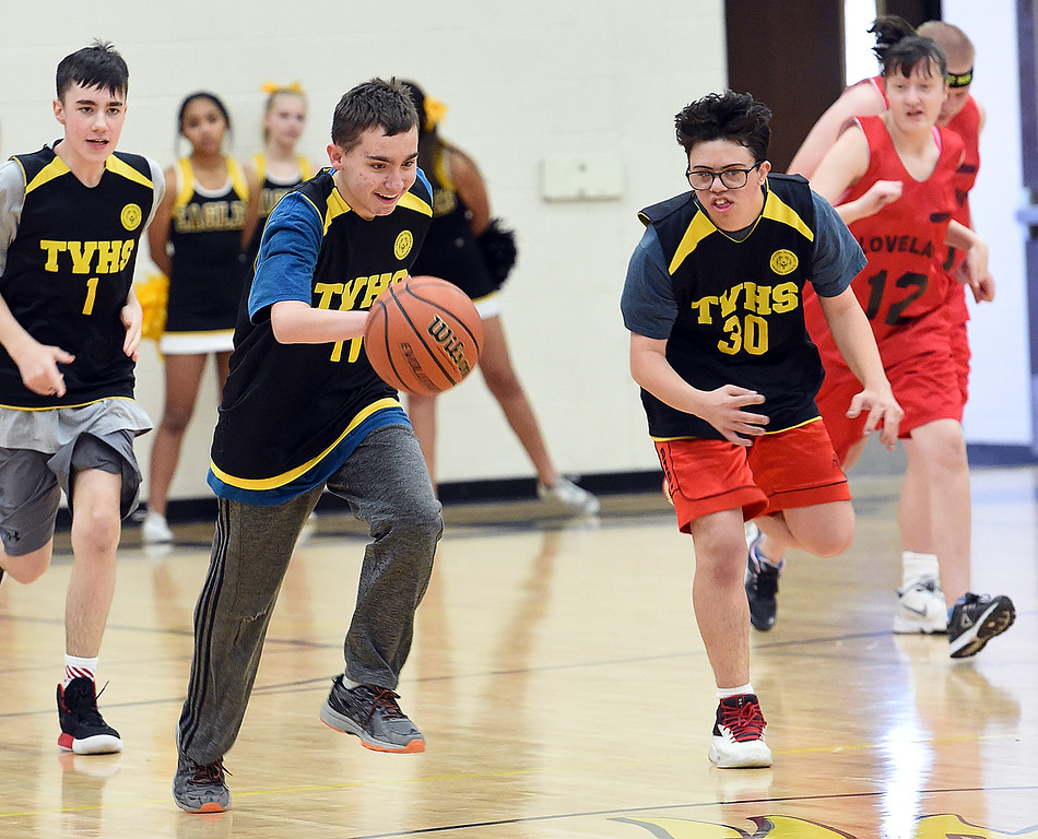 . Thompson Valley Unified\'s (11) Kaden Bernard is all smiles as he takes the ball down court during their game against Loveland Unified on Thursday, Feb. 15, 2018, at Thompson Valley High School in Loveland. (Photo by Jenny Sparks/Loveland Reporter-Herald)