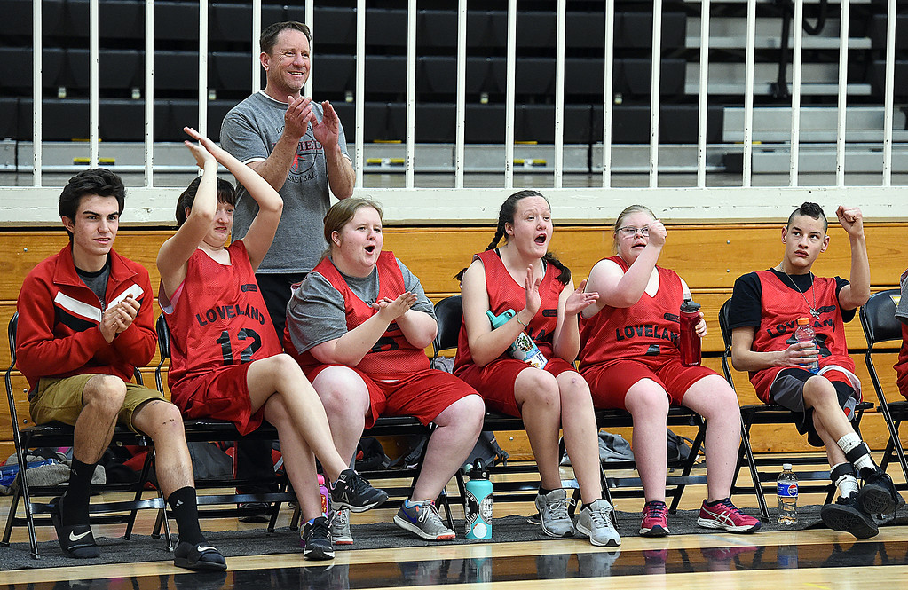 . Loveland Unified basketball players and coach Brad Nelson cheer on their team during their game against Thompson Valley Unified on Thursday, Feb. 15, 2018, at Thompson Valley High School in Loveland. (Photo by Jenny Sparks/Loveland Reporter-Herald)