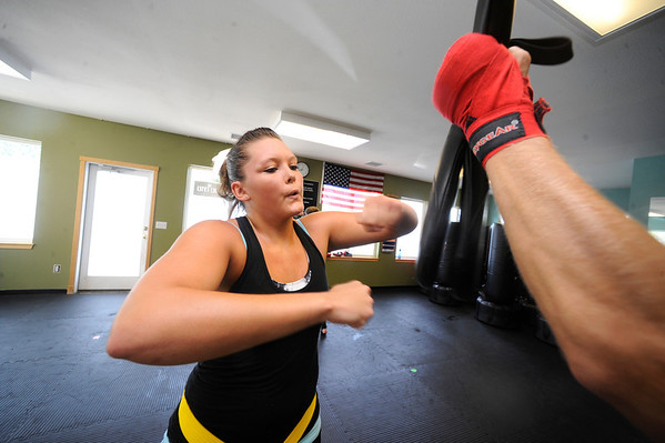 0b4355ef5b Jessica Hamlin works on a speed bag during a kickboxing class at itsera  Family Fitness in