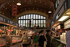 "June 23rd<br /> <br /> THE WEST SIDE MARKET...CLEVELAND, OHIO<br /> <br /> This historic landmark located on the near west side of Cleveland, was built in 1912 and not only is a building of unusual architecture, but it has a long history of being a huge indoor and outdoor market for fresh produce and  meats, fish, bakery and many other ethnic specialty foods.<br /> (History link is here for those interested in this subject  <a href=""http://cleveland.about.com/od/foodstores/p/westsidemarket.htm"">http://cleveland.about.com/od/foodstores/p/westsidemarket.htm</a> )<br /> This was taken with no flash, under pink florescent lighting (to make the meats look even more appealing, of course.)  I left the pink tone because I thought it added to the scene.  It was a very crowded day...but I managed to squeeze in one or two shot between the crowd. :-)"