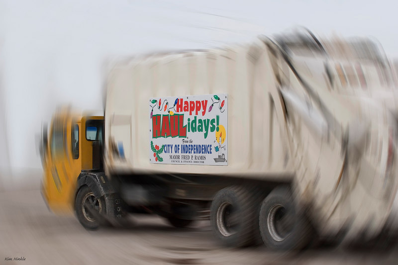 """December 6th<br /> <br /> DECK THE """"HAULS"""" WITH HOLIDAY HUMOR..FA LA LA LA LA....<br /> <br /> The manager of the service department in a suburb called Independence, Ohio, has flying squirrels in his attic at home. About every two days another flyer will come out into the open in search of food and Dave will catch it in a net and call me to come and get it.  (I will need to keep them until Spring because their main nest and food supplies are most likely in the attic).. Meanwhile,  the garbage trucks were lined up in the service yard..and all  had this sign on their sides...which cracked me up...and so I'm hoping you'll get a laugh too."""