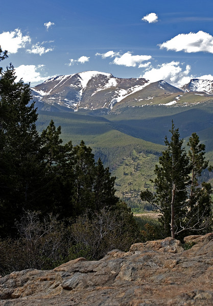 "June 12th<br /> <br /> ROCKY MOUNTAIN NATIONAL PARK<br /> <br /> We're back!!  The wedding was BEAUTIFUL!!  The scenery spectacular!  I have about 3 gigabites of memory cards to sort through, so the daunting task is ahead!  But here is the first of several I hope to post.<br /> <br /> The wedding was outside...beautiful morning changing to rain clouds, cold and wind by 4:30 for the ceremony!  We froze, but cherished every moment!  Actually,Denver broke a cold record that night...32 degrees in June!! The reception was in a tent with heat pumped in from the sides. The day after the wedding we went to Rocky Mtn National Park..drove up over 11,790 feet and over to the other side to visit a friend of Bob's for dinner.  The views were breath taking!!!  Including the ones where there were no guard rails...lol!<br /> <br /> I did not take the camera to the wedding itself.  My husband had the point and shoot, and so did my Dad, so I let them do all the photographing.  Below is a link to one of the wedding pictures they took.  HOWEVER,  hoots of hoots,  the photographer and I developed a ""friendship "" of sorts.  When he came to take the pictures, I immediately checked out the cameras...what did he use?  A 30D...with the 17-40L wide angle...which I had upstairs in the room and he had a Canon 5D.  Once we started talking, he would come over and show me pictures from time to time :-)<br /> Then he showed me a LENSBABY...cool little attachment.  So I had a lot of fun from many aspects.  I still don't believe that my son is married...amazing!!  Seems like yesterday he was a little baby....<br /> <br /> The wedding vows.. <a href=""http://mom4squirrels.smugmug.com/gallery/2992406#162172918"">http://mom4squirrels.smugmug.com/gallery/2992406#162172918</a>"