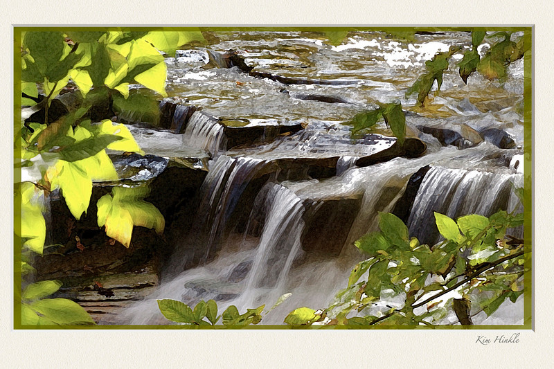 11/20/08<br /> <br /> SUMMER WATERFALL<br /> <br /> This image is another in the notecard series I am working on.  I reworked an older image and made it into a framed picture as well.<br /> More snow expected today...anyone want some?  :-(<br /> <br /> I forgot to mention that the original photo of this waterfall was printed and sold by our park system to be a part of a  nature quilt.  I have two photos that they used.  One in this series of landscapes and another was a nuthatch photo for their bird series :-)