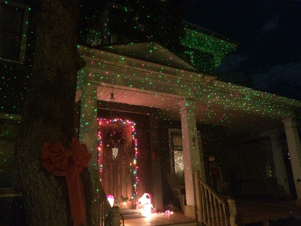 """. \""""Charlie Brown Christmas,\"""" which includes Charlie Brown and Snoopy and their Christmas tree and house covered with laser lights decorations by Mark and Sylvia Vertetis of 2 Smith Ave., Kingston. Photo by  Ivan Lajara."""