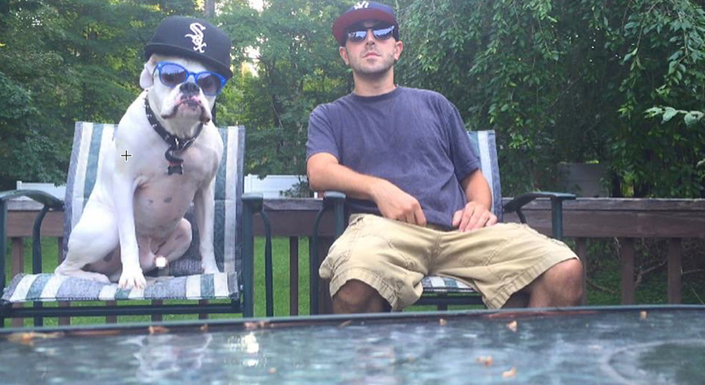 . Dubs, a 5 year-old (deaf) white boxer, and Chris Zimmer of West Hurley take second place.