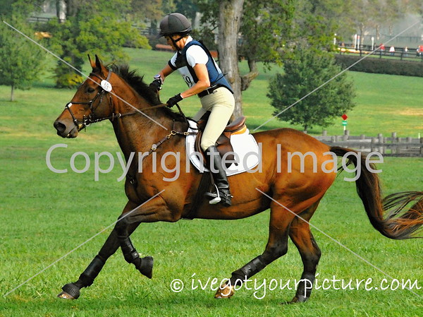 Theme:  Fast<br /> Checking her watch to be sure she's not going too FAST.<br /> Jump Start Horse Trials, 2012
