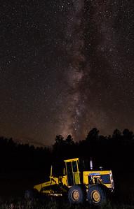 Illuminated the grader with the Milky Way