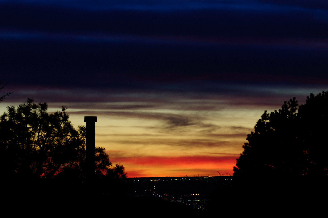 032511<br /> <br /> Another Albuquerque sunset. <br /> <br /> Again 2X to appreciate.<br /> <br /> Looking NW from the back yard, hence the neighbors vent pipe, which adds to the scene I think.