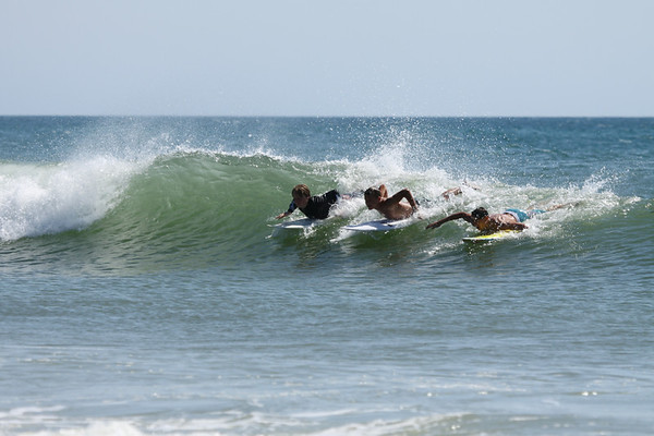 This trio hardly ever takes waves on their own! They prefer the party method.