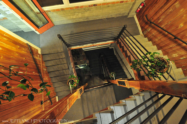 2010 01-11 A shot of the stairwell at my job.  This is looking straight down through 3 stories of stairs.  Nothing in post, although I debated changing the wb just a bit.  I didn't like the way it made the walls look, so I left it a bit yellow.