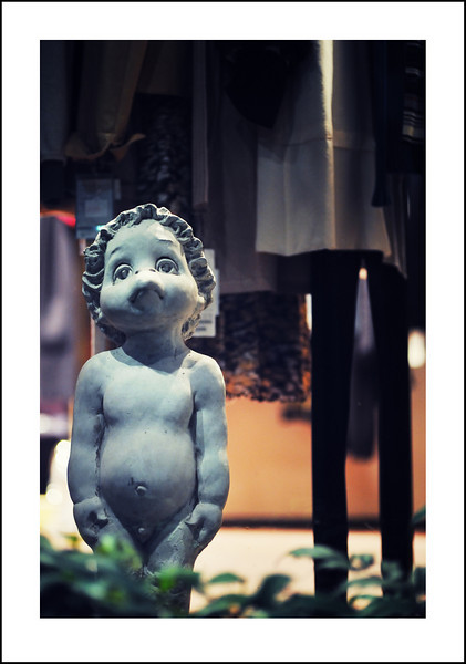 Day 281  Friday, October 8<br /> My Monday lesson has been changed to Fridays.  Every week on my way there I pass this cute boutique with a sad little Kappa in the window.  I wonder if he is sad because he doesn't have any of those fancy boutique clothes.