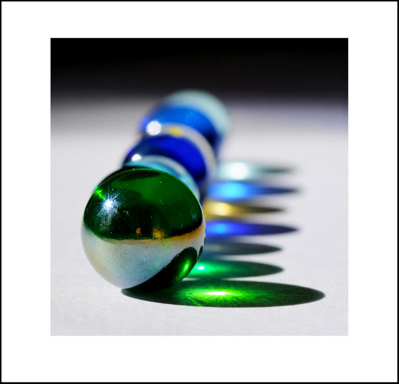 February 5.  It was another cold day, but we had a bright blue sky and lots of sun.  I decided to experiment with glass marbles on my kitchen table.
