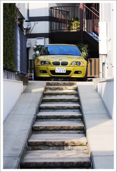January 25.  Out for a walk with Seishi's mom.  We often pass this car on our walks, so decided to take a picture of it this day.  The owner backs up this steep ramp every time he needs to park his car.  I am impressed.