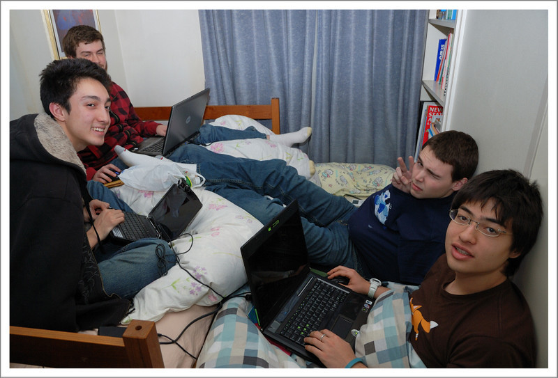 "January 1.  It is part of Japanese tradition to play games after the big New Years meal.  Here, Raymon and his 3 room mates from the U of Washington are ""playing games"" in our tiny Japanese bedroom."