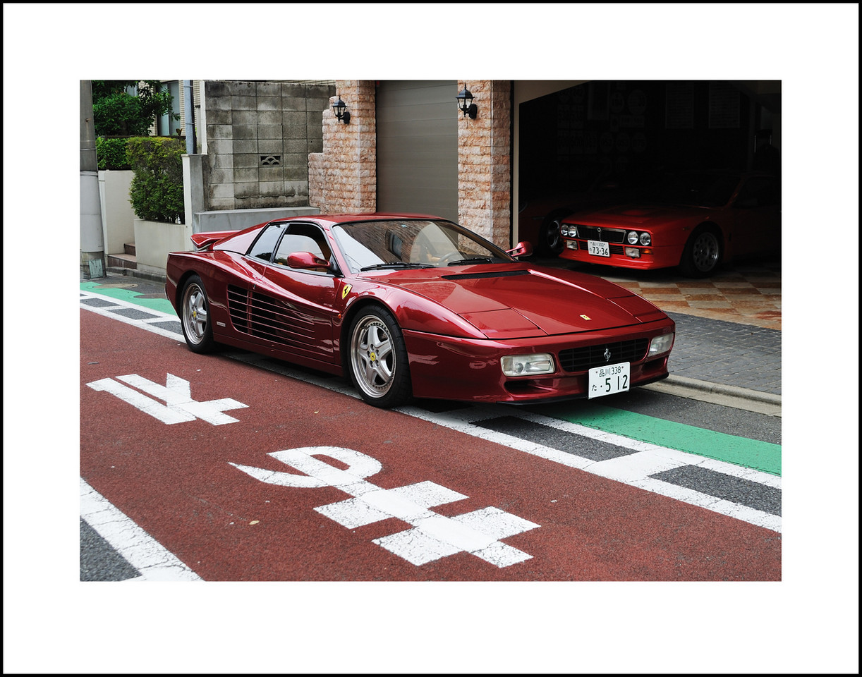 Day 179 June 28.<br /> Once in a while, we spot these high class status symbols on the streets of Tokyo. They seem a little meaningless on a 30km per hour street, but they are still cool to look at. Baba and I passed this on our walk.