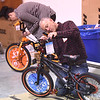 PETE  BANNAN-DIGITAL FIRST MEDIA    <br /> Mike Dolan of Havertown  and  GLenna Champion of West Chester build bicycles as part of the Pine Street Carpenters' 100 bike build workshop in West Goshen Thursday Dec. 8.