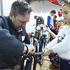 PETE  BANNAN-DIGITAL FIRST MEDIA    <br /> Adalyn,6, holds a wrench for her Dad, Carl Robinson of Downingtown as they build a bicycle as part of the Pine Street Carpenters' 100 bike build workshop in West Goshen Thursday Dec. 8.