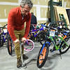 PETE  BANNAN-DIGITAL FIRST MEDIA    <br /> Arturo Castillon of West Chester fills the air in tires on a bicycle as part of the Pine Street Carpenters' 100 bike build workshop in West Goshen Thursday Dec. 8.