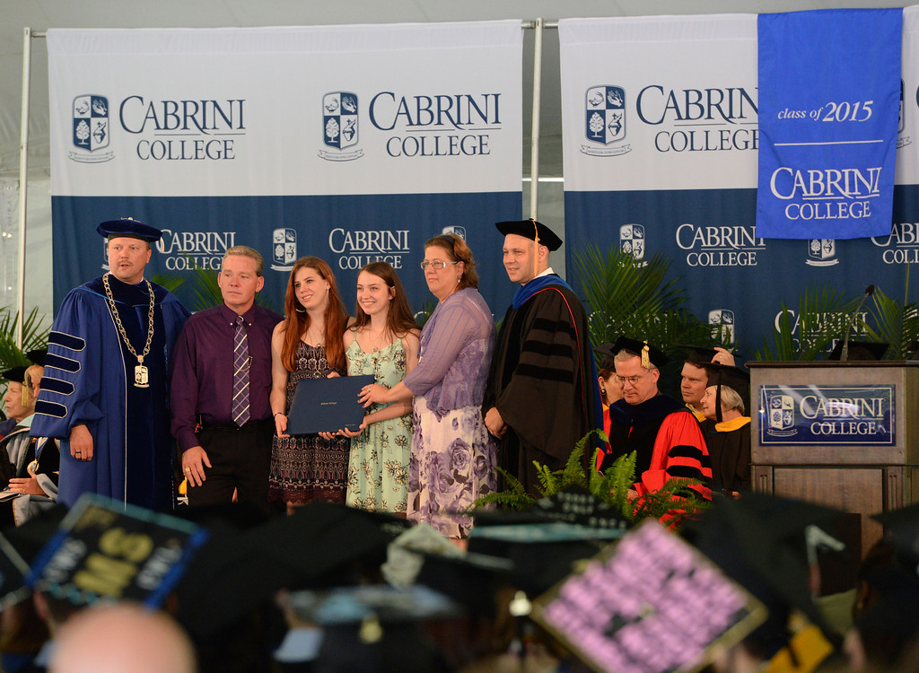 . Staff photos by Tom Kelly IV Cabrini College held their 55th annual undergraduate commencement Sunday morning at the school.  Here, the family of Rebecca Clark who died tragically in September 2014 is given an honorary degree in her name which was posthumously awarded to her.