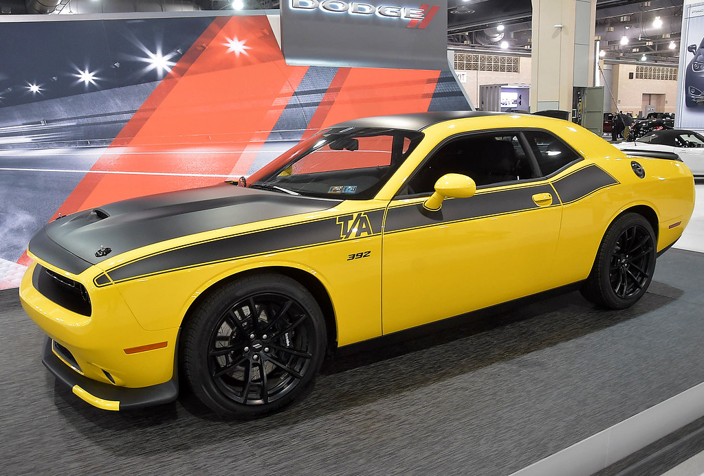 . The 2018 Challenger T/A 392 with a base price of $38,995 as shown $50,995 with HEMI engine and 8 speed automatic transmission.