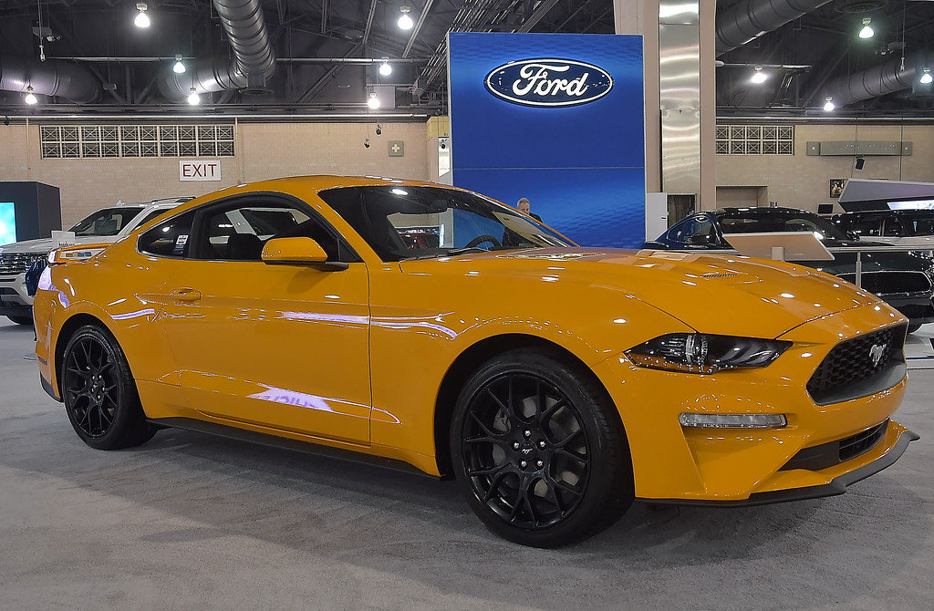 . The Ford Mustang Ecoboost coupe runs on a 2,3 liter engine with a ten speend automatic transmission. Lisy price $33,346 sporting the orange fury tricoat colors.