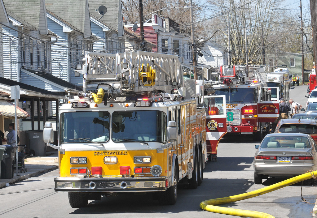 . PETE  BANNAN-DIGITAL FIRST MEDIA       FIre equipment lined 600 block of Coates St. Monday morning as firefighters from as far as Cochranville assisted at the blaze.