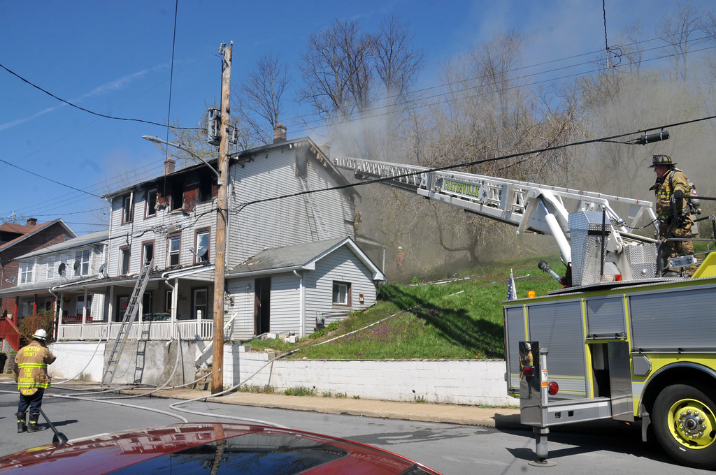 . PETE  BANNAN-DIGITAL FIRST MEDIA         Two unoccupied homes were seriously damaged in the two alarm fire on the 600 block of Coates St. Monday morning.
