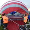 PETE BANNAN-DIGITAL FIRST MEDIA  Volunteers assist  filling the USA Rocket at the Chester County Balloon Festival Friday evening Jun 24, 2016 at New Garden Airport. The event runs through Sunday.