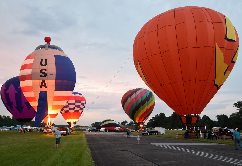 . PETE BANNAN-DIGITAL FIRST MEDIA  The balloon glow at the Chester County Balloon Festival Friday evening Jun 24, 2016 at New Garden Airport. The event runs through Sunday, with another glow and fireworks Saturday evening.