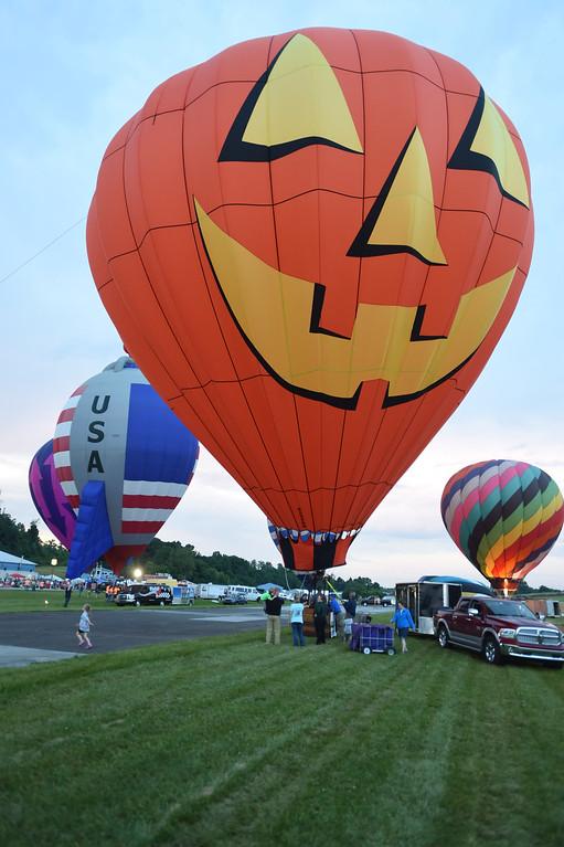 . PETE BANNAN-DIGITAL FIRST MEDIA  A  balloon glow at the Chester County Balloon Festival Friday evening Jun 24, 2016 at New Garden Airport. The event runs through Sunday.