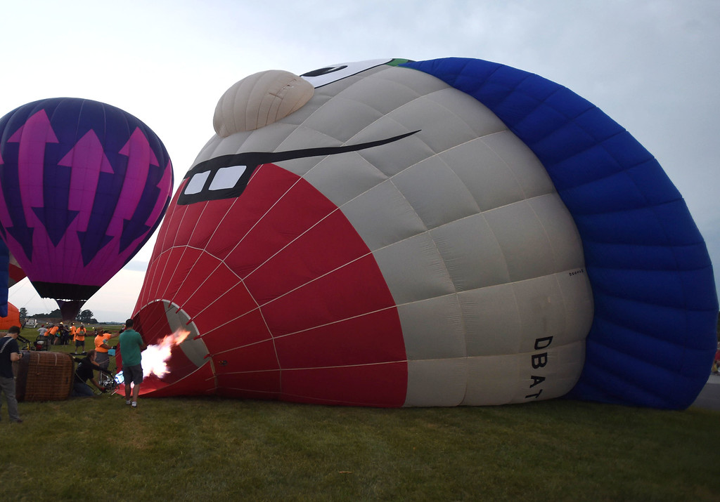. PETE BANNAN-DIGITAL FIRST MEDIA   Dingbat- Stay in School from Southern tier New York inflates at the Chester County Balloon Festival Friday evening Jun 24, 2016 at New Garden Airport. The event runs through Sunday.