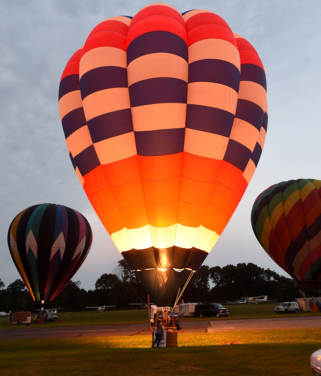 . PETE BANNAN-DIGITAL FIRST MEDIA  A  balloon glow at the Chester County Balloon Festival Friday evening Jun 24, 2016 at New Garden Airport. The event runs through Sunday.