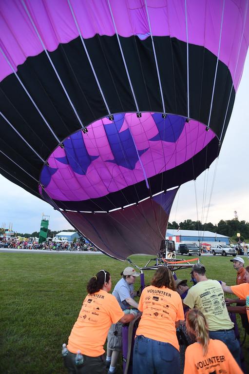 . PETE BANNAN-DIGITAL FIRST MEDIA  A  balloon lifts up at the Chester County Balloon Festival Friday evening Jun 24, 2016 at New Garden Airport. The event runs through Sunday.