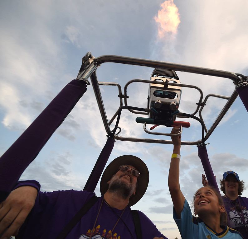 . PETE BANNAN-DIGITAL FIRST MEDIA  Amiyah Prieve,13, of Newport  gets a chance to fire the propane jets on Keith Sproul\'s balloon at the Chester County Balloon Festival Friday evening Jun 24, 2016 at New Garden Airport. The event runs through Sunday.