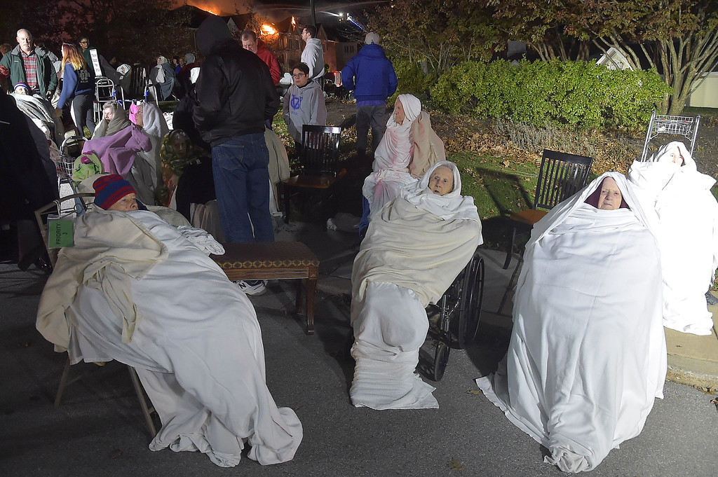 . PETE BANNAN-DIGITAL FIRST MEDIA   	Residents of the Barclay Friends Home wait under blankets as the senior care facility burned in a horrific fire late Thursday evening. Hundreds of residents were evacuated from after an explosion and fire destroyed the home.