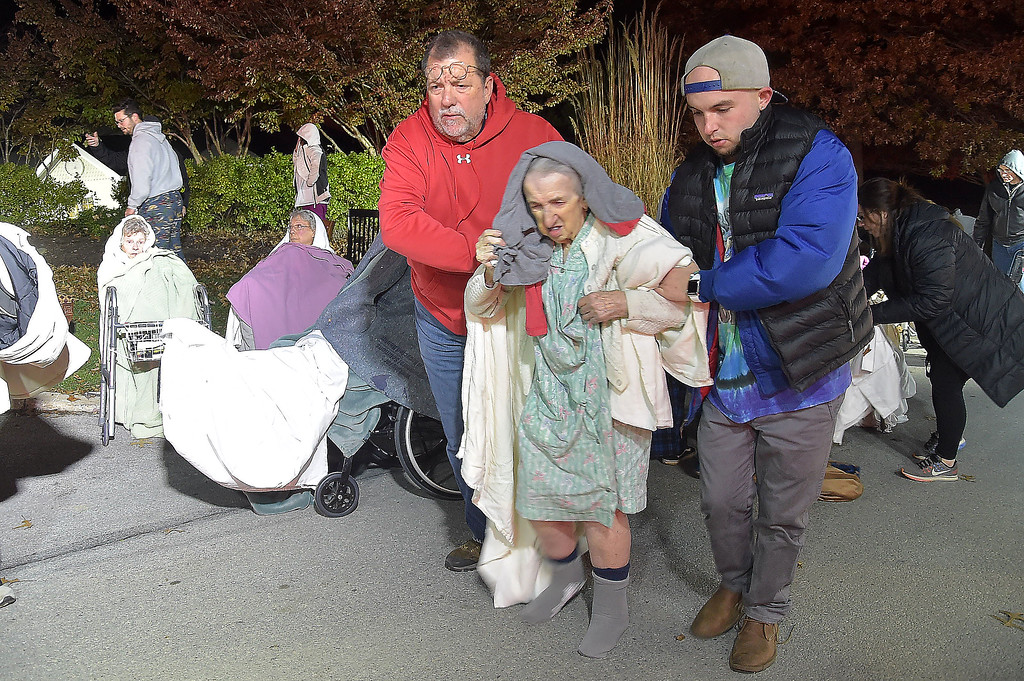 . PETE BANNAN-DIGITAL FIRST MEDIA   	A resident of the Barclay Friends Home is assisted away from the scene as the senior care facility burned in a horrific fire late Thursday evening. Hundreds of residents were evacuated from after an explosion and fire destroyed the home.