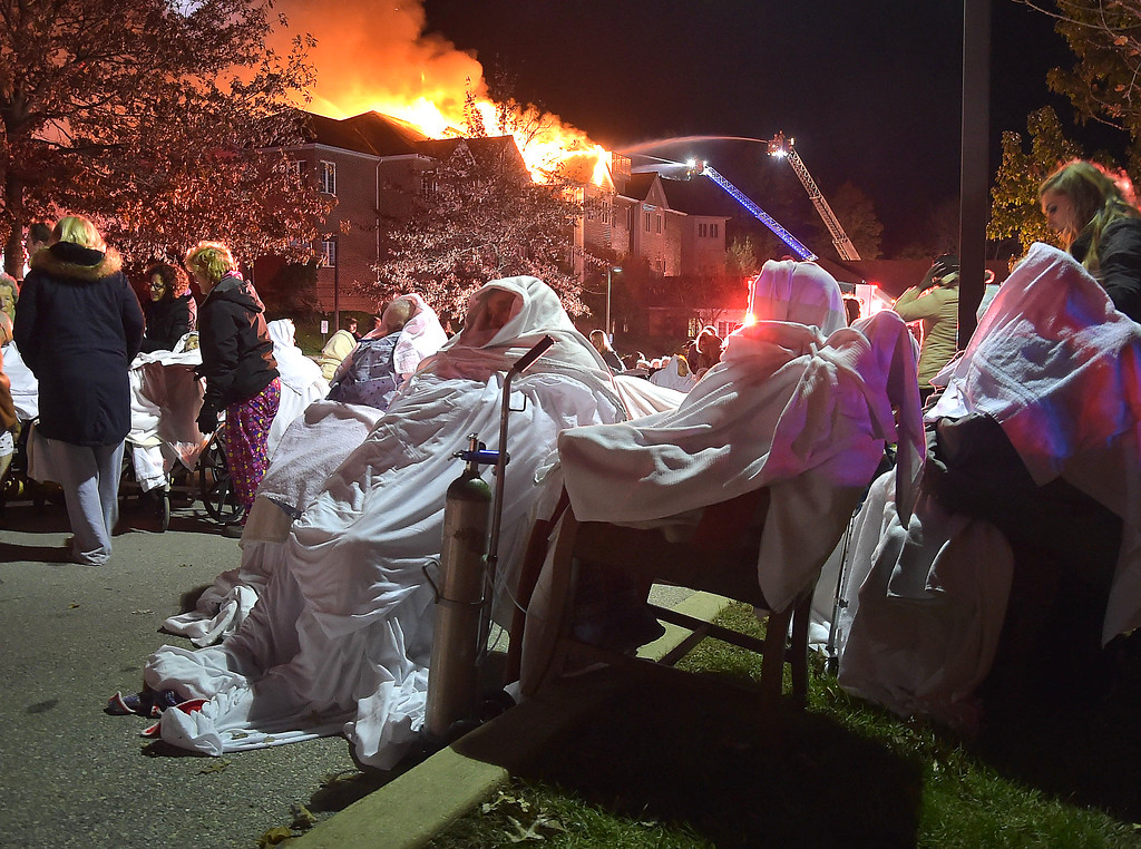 . PETE BANNAN-DIGITAL FIRST MEDIA   	Residents of the Barclay Friends Home in West Chester wait to be taken to ambulances as the senior care facility burned in a horrific fire late Thursday evening. Hundreds of residents were evacuated from after an explosion and fire destroyed the home.
