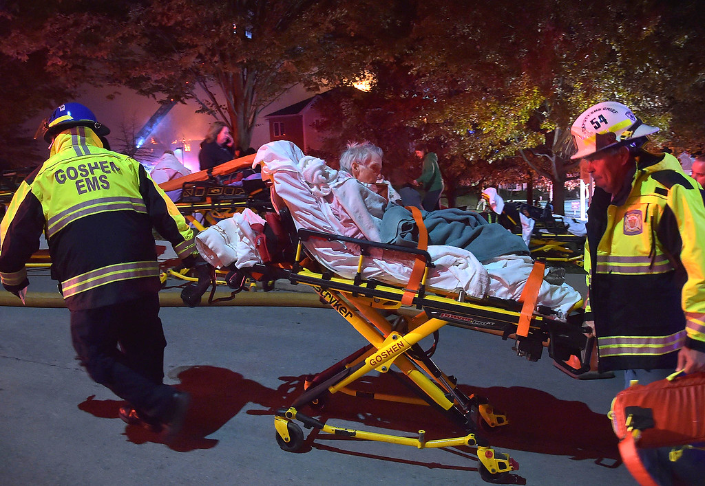 . PETE BANNAN-DIGITAL FIRST MEDIA   	A resident of the Barclay Friends Home is transported by Goshen EMS as the senior care facility burned in a horrific fire late Thursday evening. Hundreds of residents were evacuated from after an explosion and fire destroyed the home.